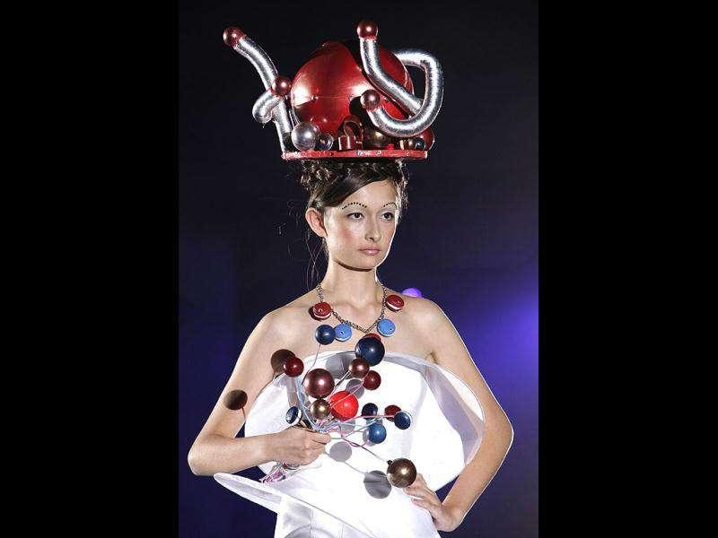A model displays a headpiece made of confectionery during the Tokyo Sweets Collection in Tokyo. AP