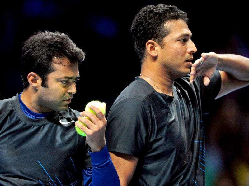 Leander Paes (L) and his partner Mahesh Bhupathi of India (R) talk between points against Jurgen Melzer of Austria and his partner Philipp Petzschner of Germany during their group A doubles match in the round robin stage on day four of the ATP World Tour Finals tennis tournament in London. AFP Photo/Leon Neal