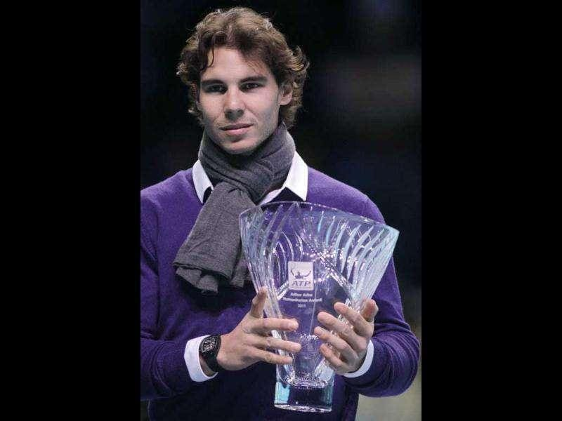 Spain's Rafael Nadal poses with his Arthur Ashe Humanitarian Award presented to him at the ATP World Tour Finals at O2 Arena in London.