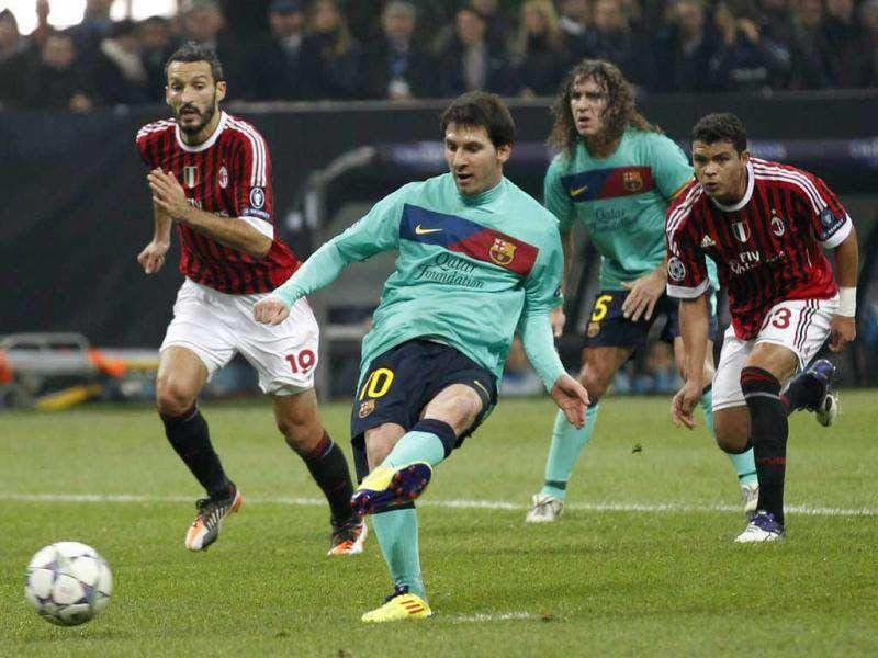 Barcelona forward Lionel Messi kicks a penalty during a Champions League, Group H soccer match between AC Milan and Barcelona at the San Siro stadium in Milan, Italy.