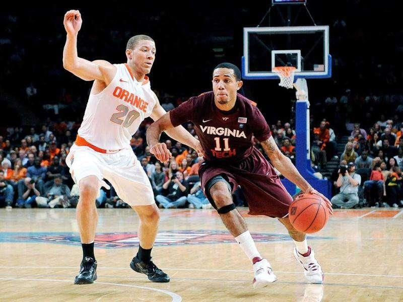 Erick Green of the Virginia Tech Hokies drives the ball against Brandon Triche of the Syracuse Orange during the 2011 Dick's Sporting Goods NIT Season Tip-Off at Madison Square Garden in New York City.