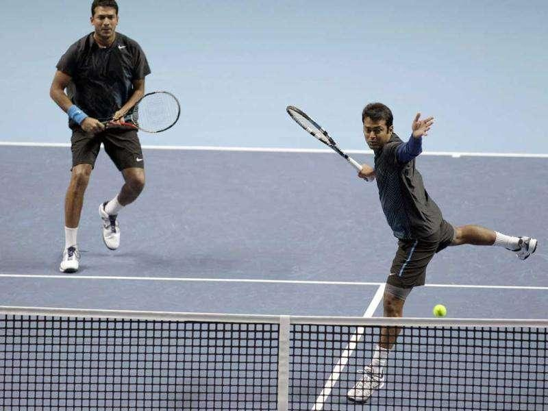 Mahesh Bhupathi and Leander Paes, right, play a return to Jurgen Melzer and Philipp Petzschner during a round robin double tennis match at the ATP World Tour Finals at O2 Arena in London.