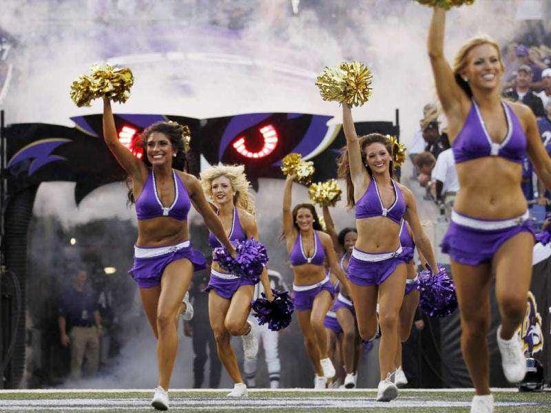 Baltimore Ravens 2011 cheerleaders run onto the field during a game at M&T Bank Stadium in Baltimore, Maryland.