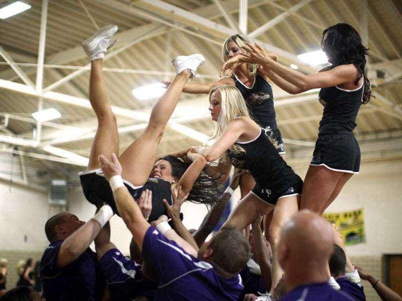 Cheerleader hopefuls prepare prior to performance during tryouts for the Ravens cheerleaders in Baltimore.