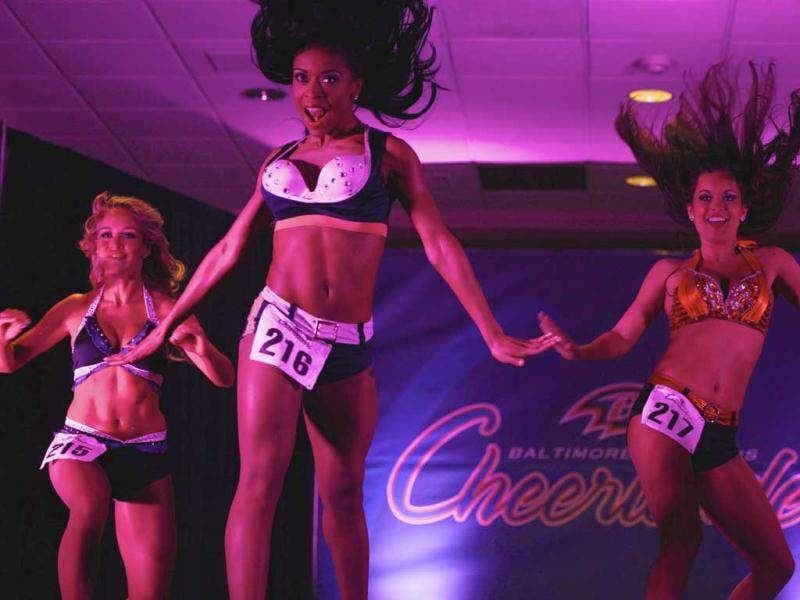 Cheerleader hopefuls perform during an event called