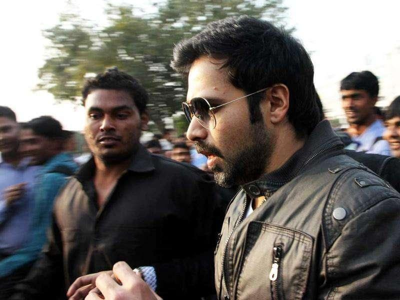 A crowd engulfs Emraan on his way to the Rajiv Chowk metro station.
