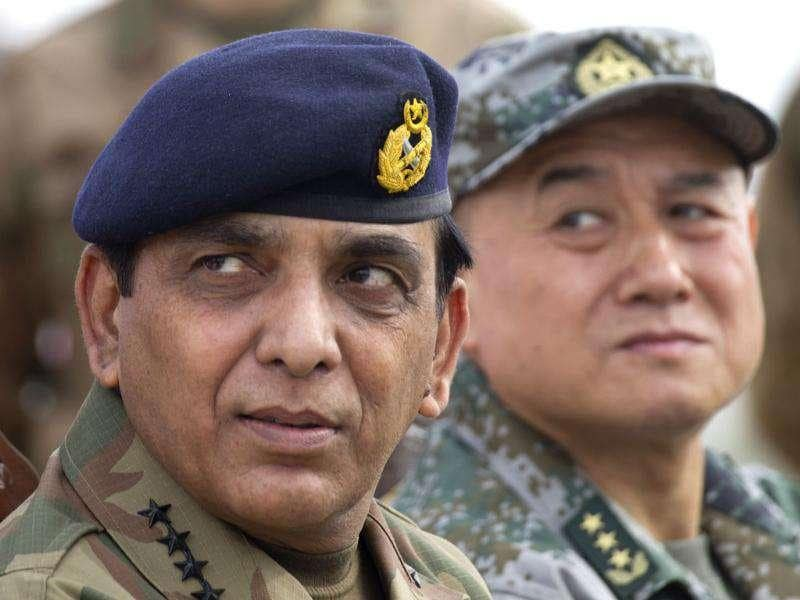 Pakistan army Chief Gen. Ashfaq Parvez Kayani (L) listens to a reporter during a joint press conference with General Hou Shusen, Deputy Chief of the People's Liberation Army, China, at the conclusion of a joint exercise in Jhelum, Pakistan. AP Photo/BK Bangash