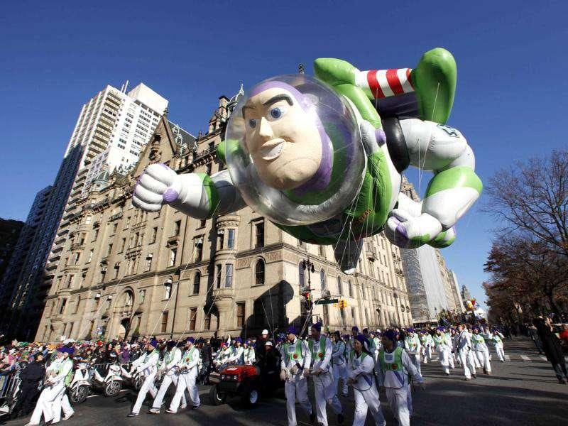 The Buzz Lightyear balloon floats down Central Park West during the 85th Macy's Thanksgiving day parade in New York.