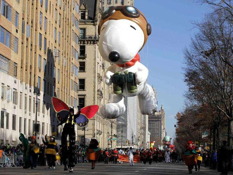 The Snoopy the Flying Ace balloon floats down Central Park West during the 85th Macy's Thanksgiving day parade in New York.