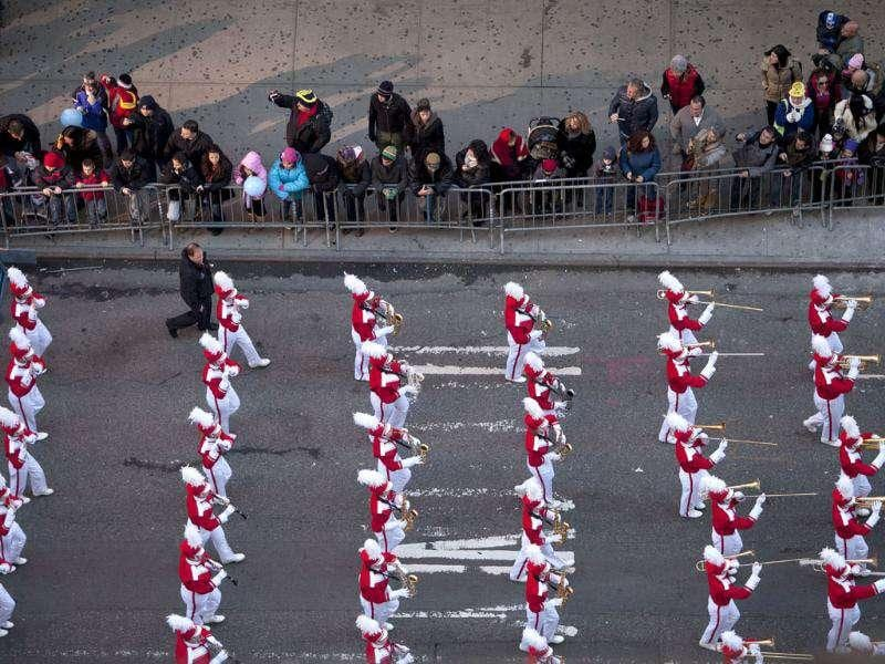 A band marches through Time Square during the Macy's Thanksgiving Day Parade in New York.