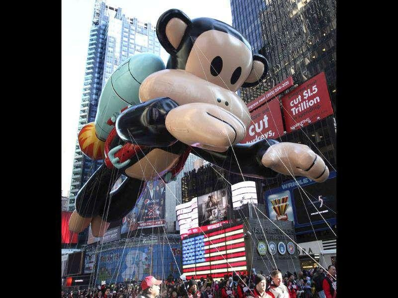 The Julius the Monkey balloon floats through Times Square during the 85th annual Macy's Thanksgiving day parade in New York.