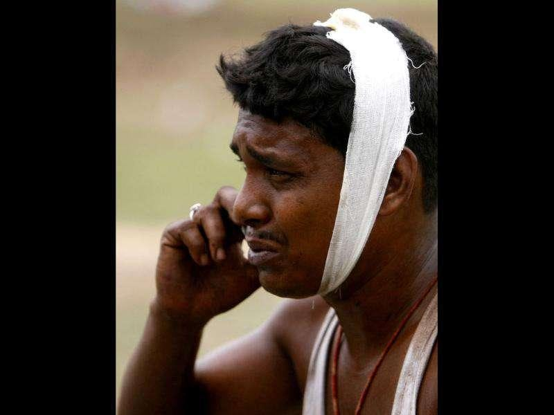 An injured passenger speaks on a mobile phone at the site of a train accident at Jhargram area in West Bengal on May 28, 2010. Maoists sabotaged the high-speed train that killed at least 71 people after it smashed into the path of a goods train. Reuters/Parth Sanyal
