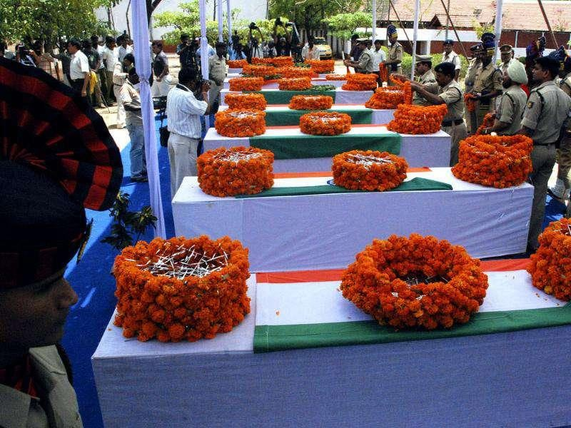 Senior police officials lay wreaths on the flag-draped coffins of their colleagues in Raipur on May 9, 2010. Seven policemen were killed after their vehicle hit a landmine planted by Maoist rebels in Bijapur. Reuters