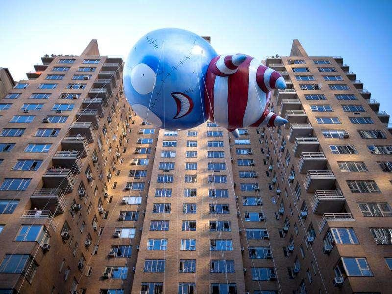 Filmmaker Tim Burton's 'B' floats along 59th Street during Macy's Thanksgiving Day Parade in New York.