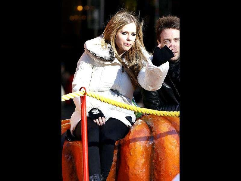 Singer Avril Lavigne waves as she makes her way on a float around Columbus Circle during the 85th annual Macy's Thanksgiving day parade in New York.