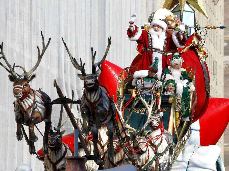 Santa Claus rides on his sleigh down Central Park West during the 85th Macy's Thanksgiving day parade in New York.