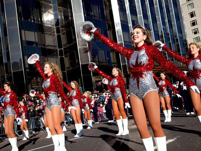 Cheerleaders from the Homewood High School Patriot Band, in Alabama, march and cheer during Macy's Thanksgiving Day Parade in New York.