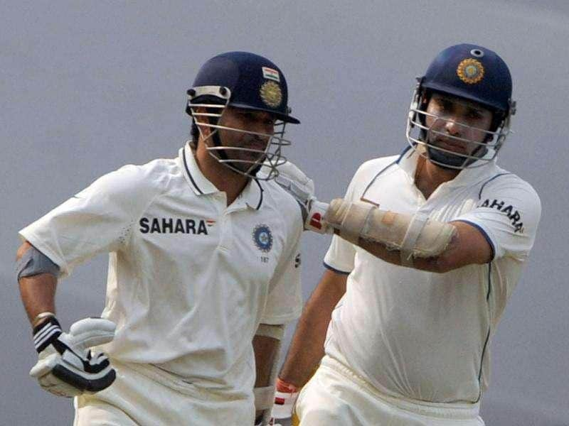 Sachin Tendulkar (L) and teammate VVS Laxman prepare to bat during fourth day's play of the third Test cricket match between India and the West Indies at The Wankhede Stadium in Mumbai.