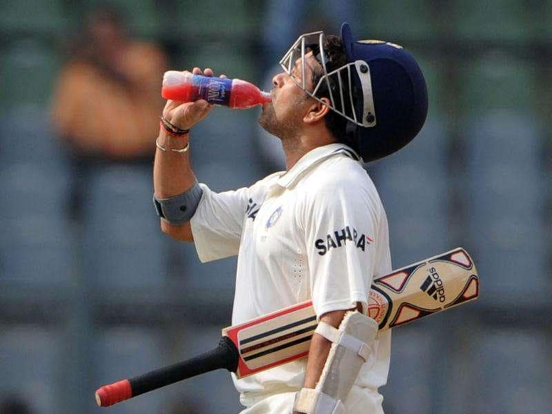 Sachin Tendulkar drinks an energy supplement while batting during the fourth day of the third Test cricket match between India and West Indies at The Wankhede Stadium in Mumbai.