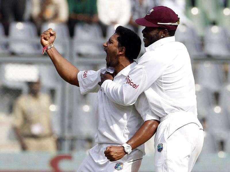 West Indies' Ravi Rampaul and Kirk Edwards (R) celebrate the dismissal of Sachin Tendulkar during the fourth day of their third and final Test cricket match in Mumbai.