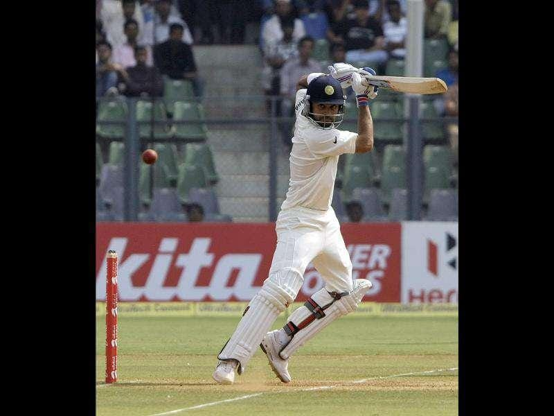 Virat Kohli plays a shot during the fourth day of their third and final Test cricket match against West Indies in Mumbai.