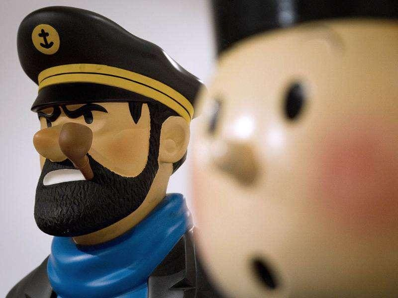 Sculptures of Captain Haddock (L) by artists Leblon Delienne and Tintin at the Artcurial auction house in Paris.