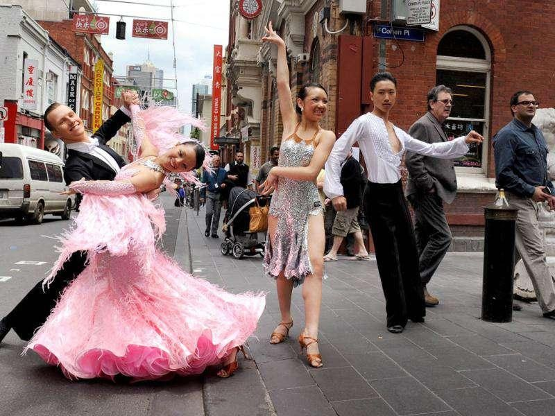 Dancers perform in Melbourne's Chinatown in front of the lunchtime crowds to promote the upcoming WDSF Asian Pacific DanceSport Championship.