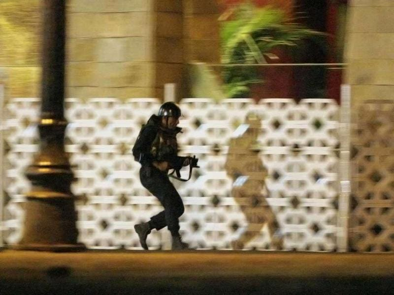A commando takes up position during an ongoing gun battle at the Taj Mahal Hotel in Mumbai. Reuters photo