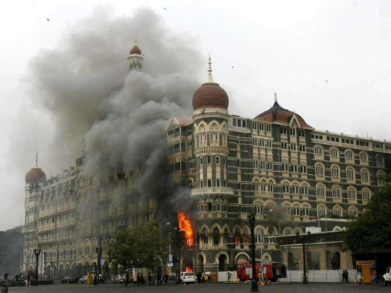 The Taj Mahal hotel is seen engulfed in smoke during a gun battle in Mumbai. Reuters/Arko Datta