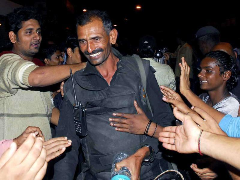 People congratulate a National Security Guard (NSG) commando as he leaves the Nariman House after an operation, in Mumbai. Reuters photo