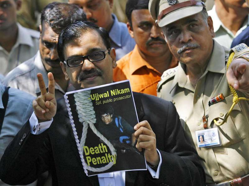 Special prosecutor Ujjwal Nikam gestures as he speaks to the media outside Arthur Road Jail, where the trial of Mohammad Ajmal Kasab, the lone surviving gunman of the 2008 Mumbai attacks, was held, in Mumbai. Reuters/Arko Datta