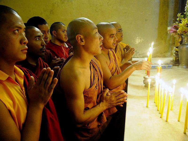 Buddhist monks offer prayers to victims on the third anniversary of the 2008 Mumbai militant attacks, at the Bodhgaya Mahabodi Temple in Bodh district.