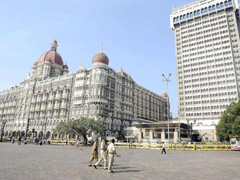 Policemen patrol in front of the landmark Taj Mahal and Palace Hotel on the third anniversary of the 2008 militant attacks in Mumbai.