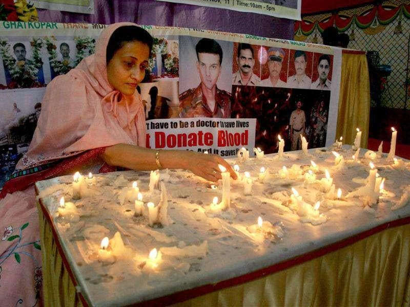 A woman lights candles to to pay tribute to the victims of 26/11 Mumbai terror attack, to mark its 3rd anniversary, at CST railway station in Mumbai.