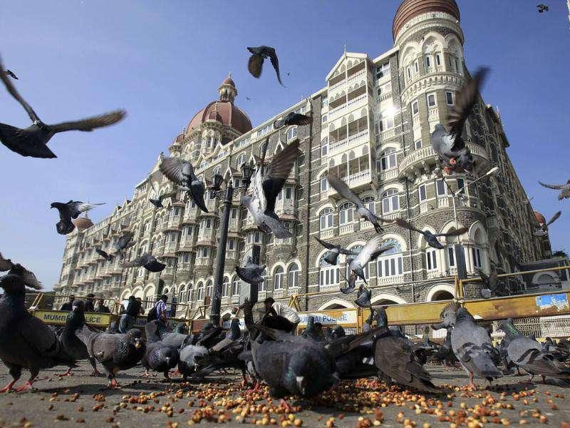 Pigeons fly outside the Taj Mahal Hotel, one of the sites of the Mumbai attack, on the third anniversary of the attack in Mumbai.
