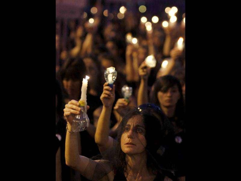Uruguayan women wearing black dresses and veils hold candles as they demonstrate against domestic violence along 18 de Julio street in Montevideo. Friday marks the International Day for the Elimination of Violence against Women. Around 40 women die every year in Uruguay as a result of domestic violence, according to official sources. (REUTERS/Andres Stapff)