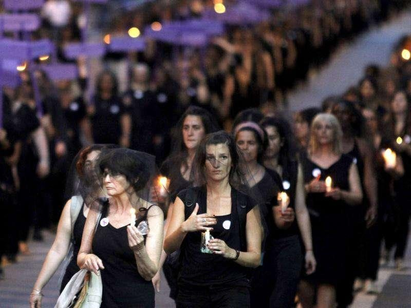 Uruguayan women wearing black dresses and veils hold candles as they demonstrate against domestic violence along 18 de Julio street in Montevideo. Friday marked the International Day for the Elimination of Violence against Women. Around 40 women die every year in Uruguay as a result of domestic violence, according to official sources. (REUTERS/Andres Stapff)