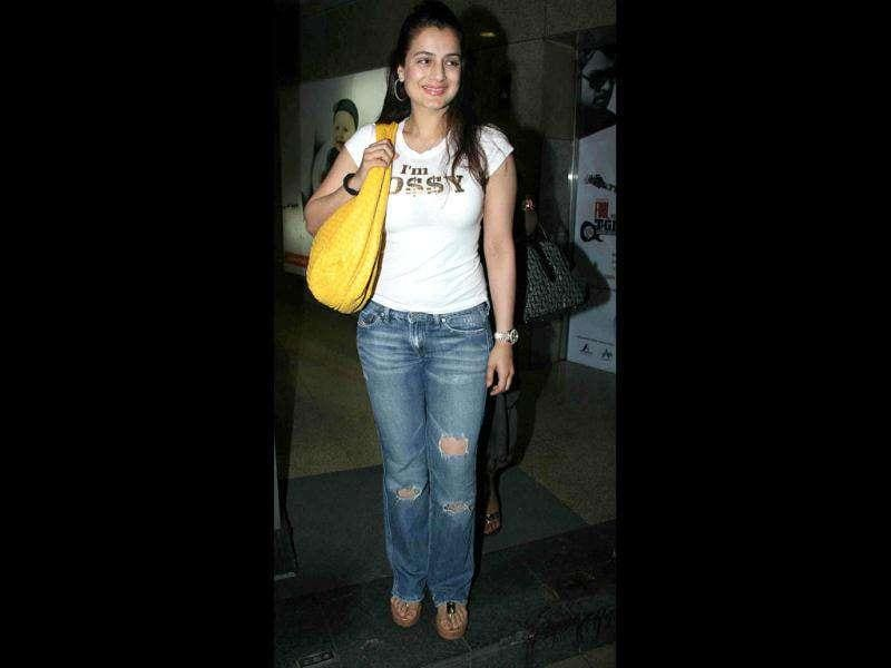 Amisha Patel plays safe in a white tee over blue jeans but doesn't look too great.