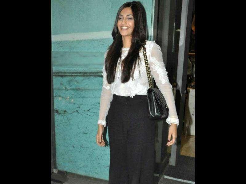 Sonam Kapoor in a black-white outfit.