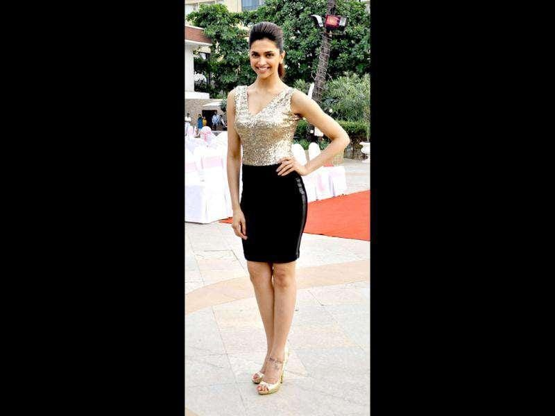 Deepika Padukone looks absolutely stunning in a golden sequins top over black skirt.