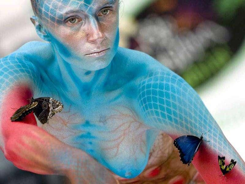 A body-painted model performs during the Biofashion Habitat show in Cali, Valle del Cauca department, Colombia.