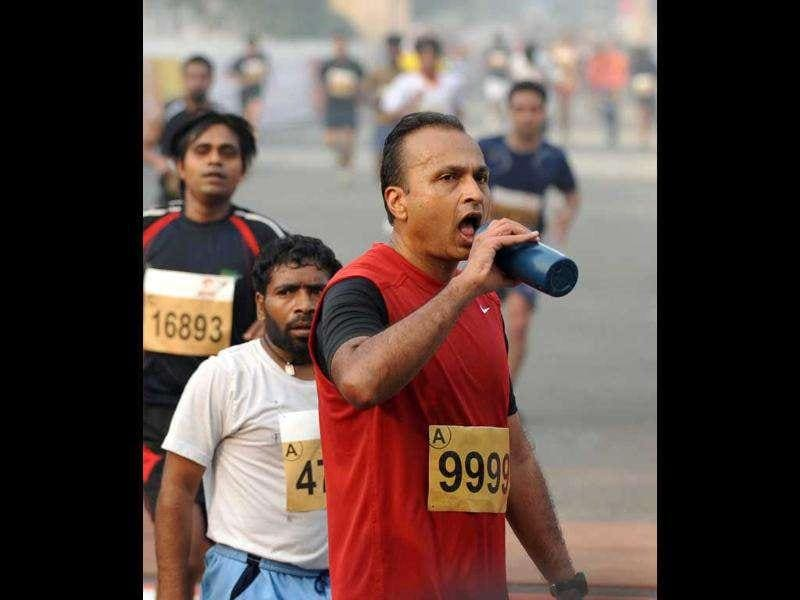 Industrialist Anil Ambani, chairman of Reliance Anil Dhirubhai Ambani Group, drinks as he competes in the Airtel Delhi Half Marathon 2011 in New Delhi.