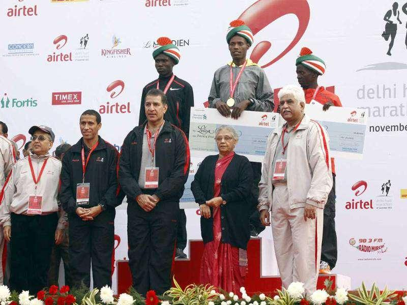 The winners of the Airtel Delhi Half Marathon, along with (L to R) Smt Sindhushree Kullar, IAS, secretary, ministry of youth affairs & sports; event ambassador Khalid Khannouchi, Rajan Mittal, vice chairman & MD, Bharti Enterprise, Mrs Sheila Dikshit, chief minister of Delhi and Rakesh Mittal, vice chairman and MD, Bharti Enterprise.