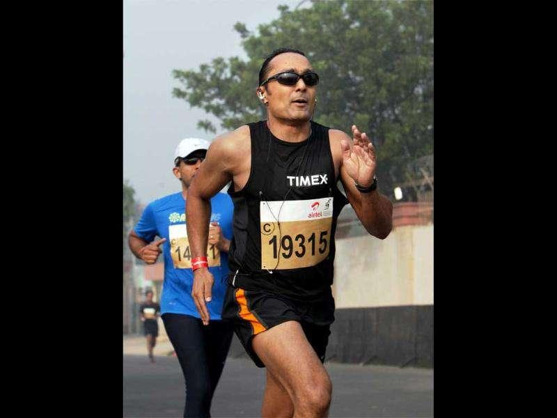 Actor Rahul Bose runs during the Airtel Delhi Half Marathon 2011 in New Delhi.
