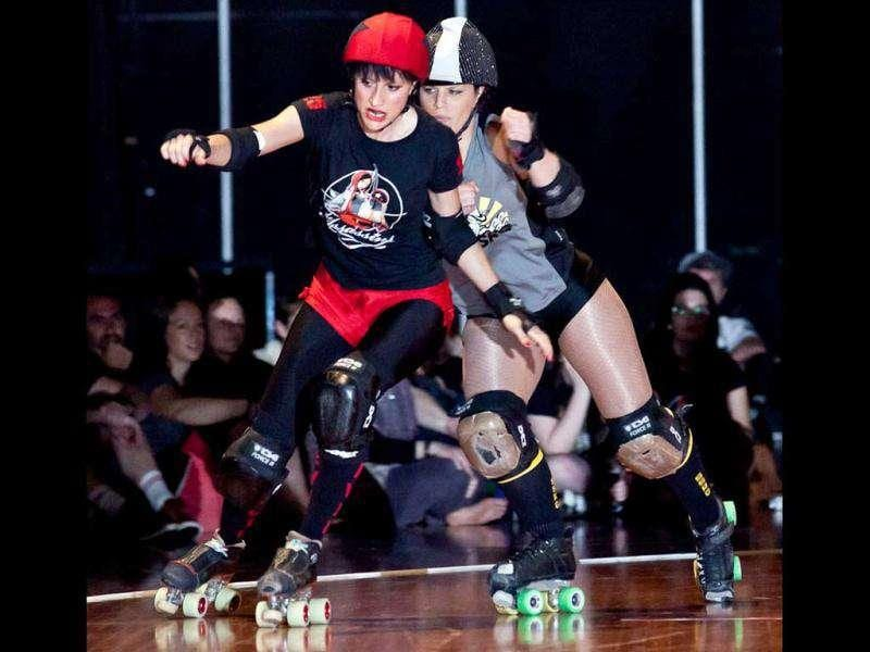 Handout photo taken by Kim Lee shows roller derby teams in action in Sydney.