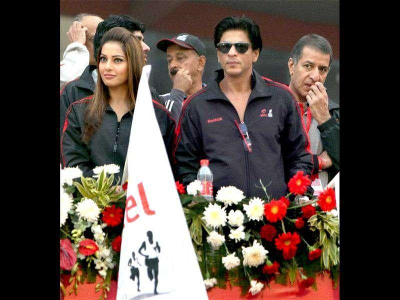 SRK-Bips are dressed alike in same zipper jackets. (Photo: PTI)