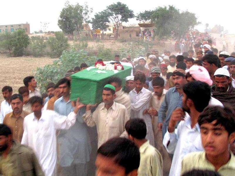 Relatives and area residents carry the coffin of a Pakistani soldier who was killed in a Nato strike during his funeral ceremony in Bhakkar district.