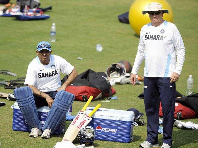 India's Virender Sehwag (L) and coach Duncan Fletcher discuss a point during a cricket training session at The Barabati Stadium in Cuttack.