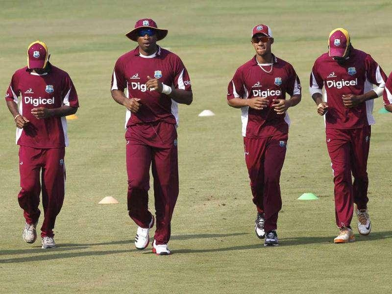 West Indies' players jog during a practice session ahead of their first one-day international cricket match against India in Cuttack.