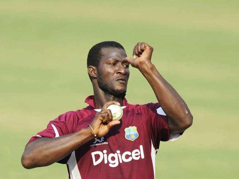 West Indies captain Darren Sammy bowls to the nets during a cricket training session at The Barabati Stadium in Cuttack.